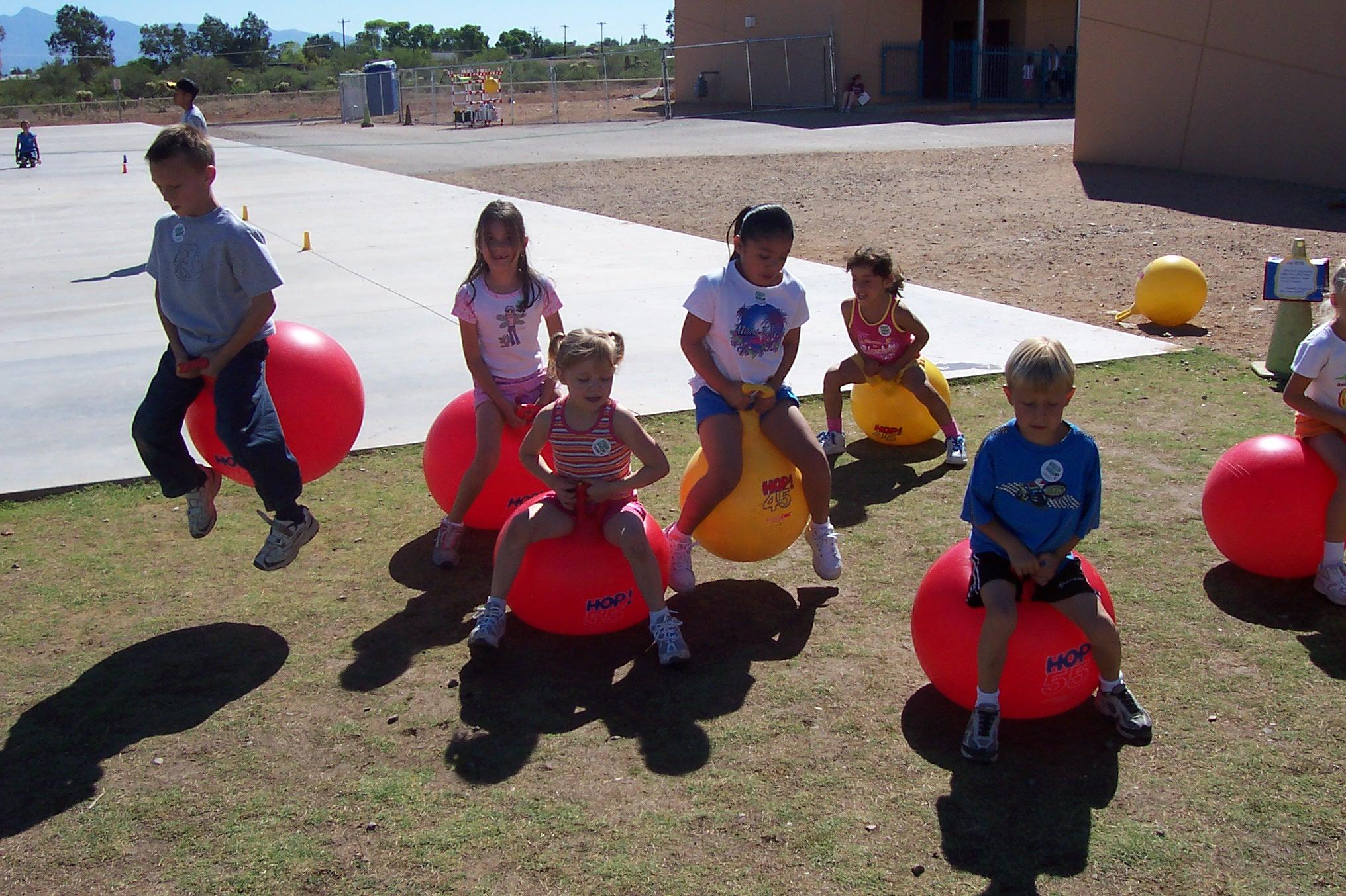 kids on bouncy balls