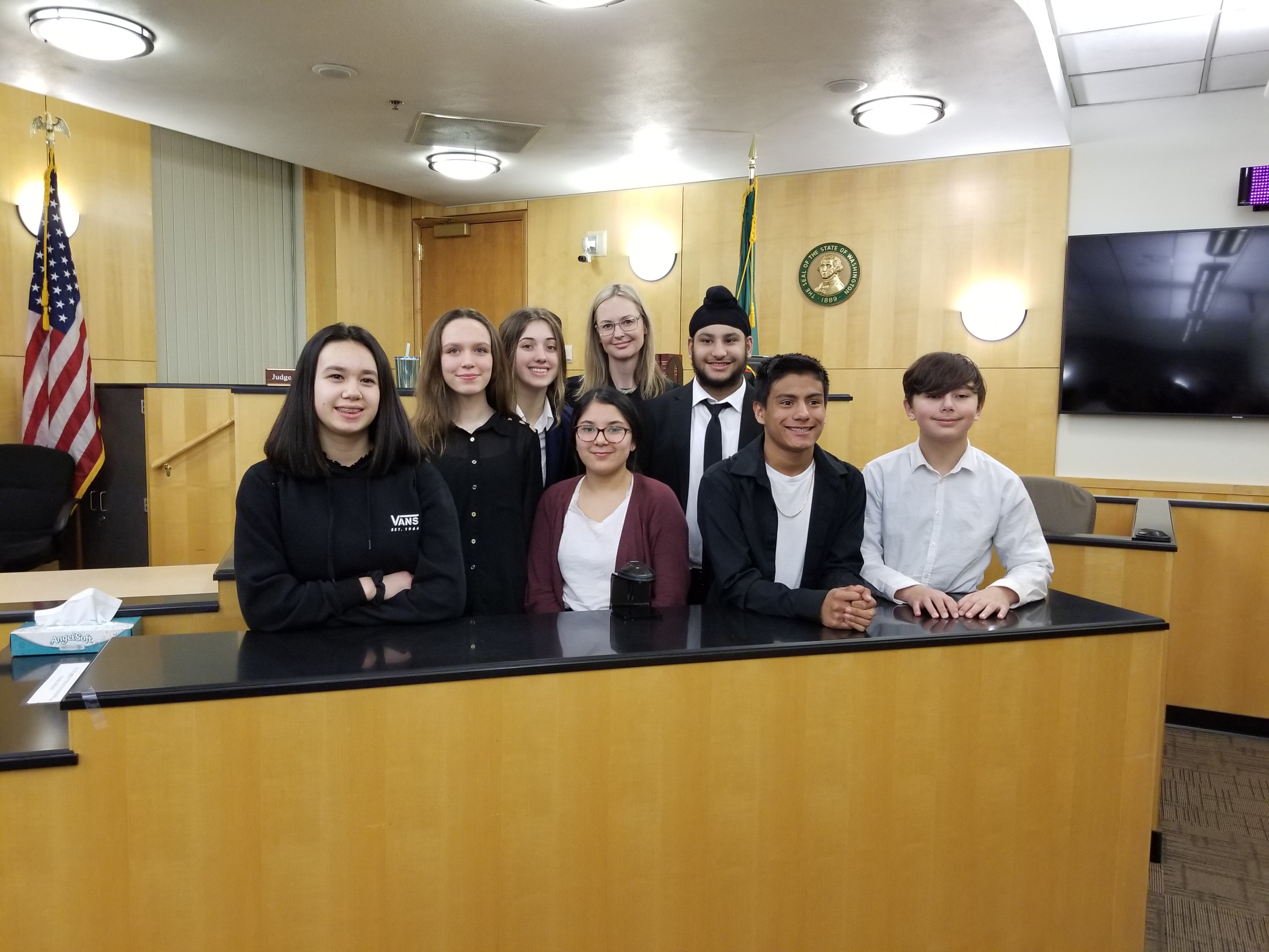 A photo of a group of students in a mock trial
