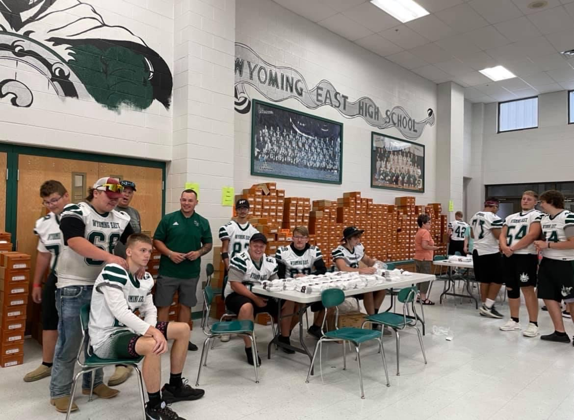 FOOTBALL PLAYERS IN LUNCH ROOM
