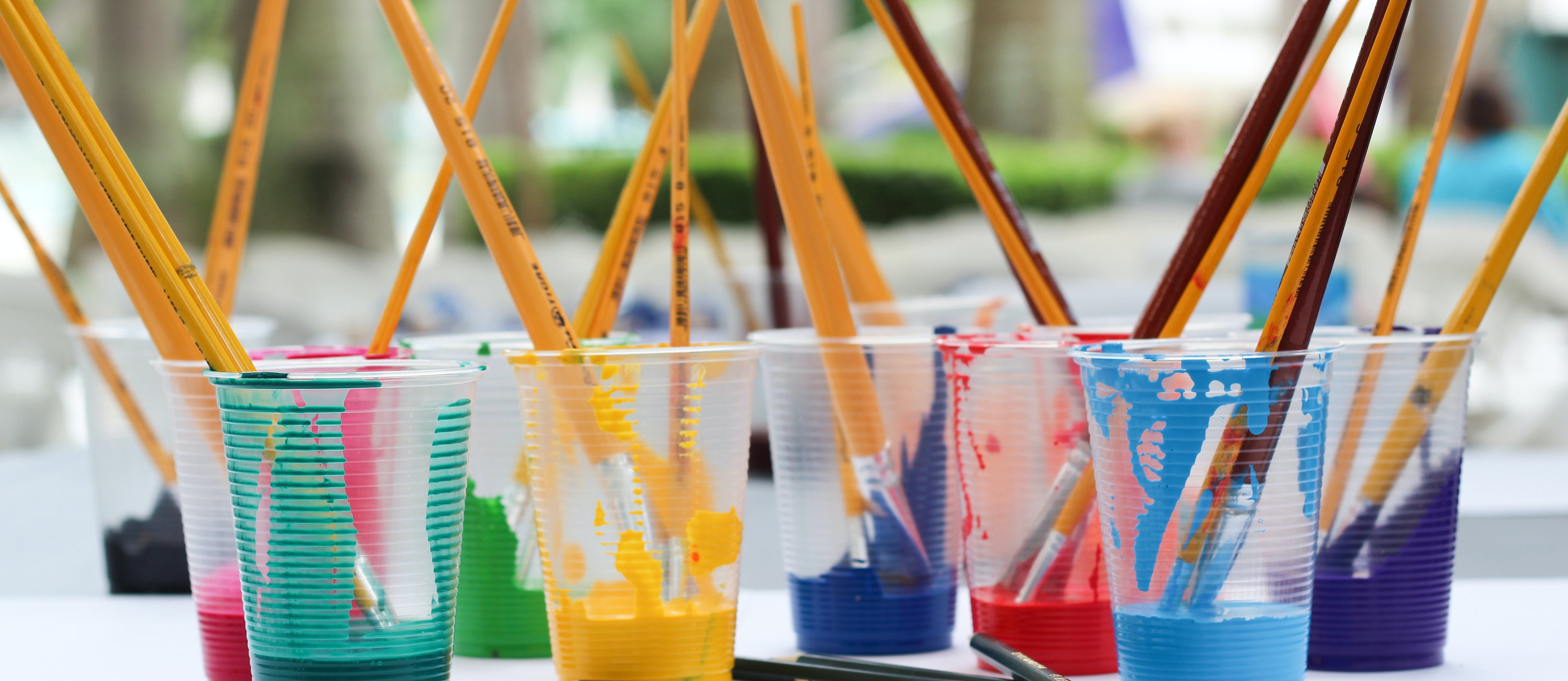paint and brushes in cups