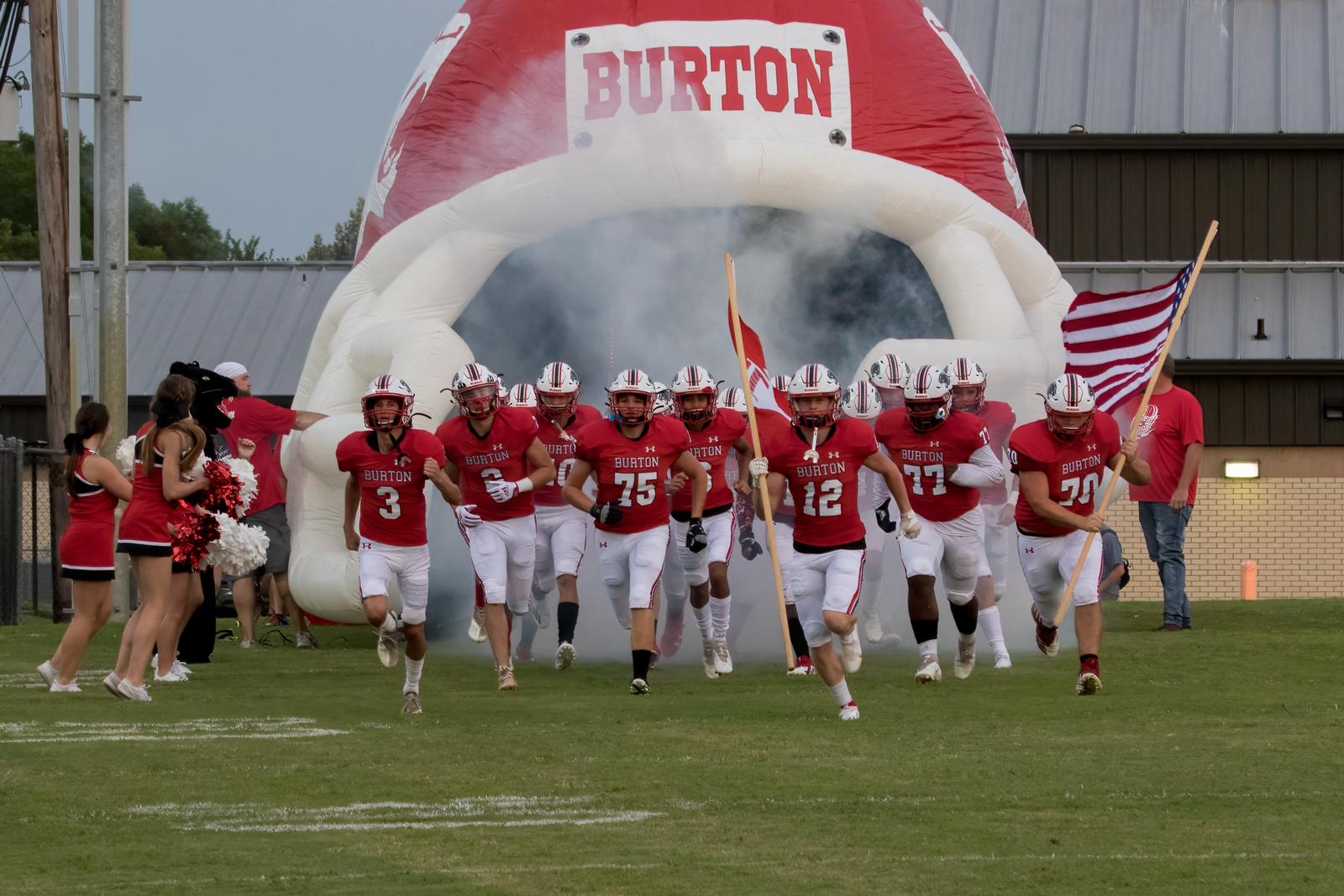 Football team running through helmet