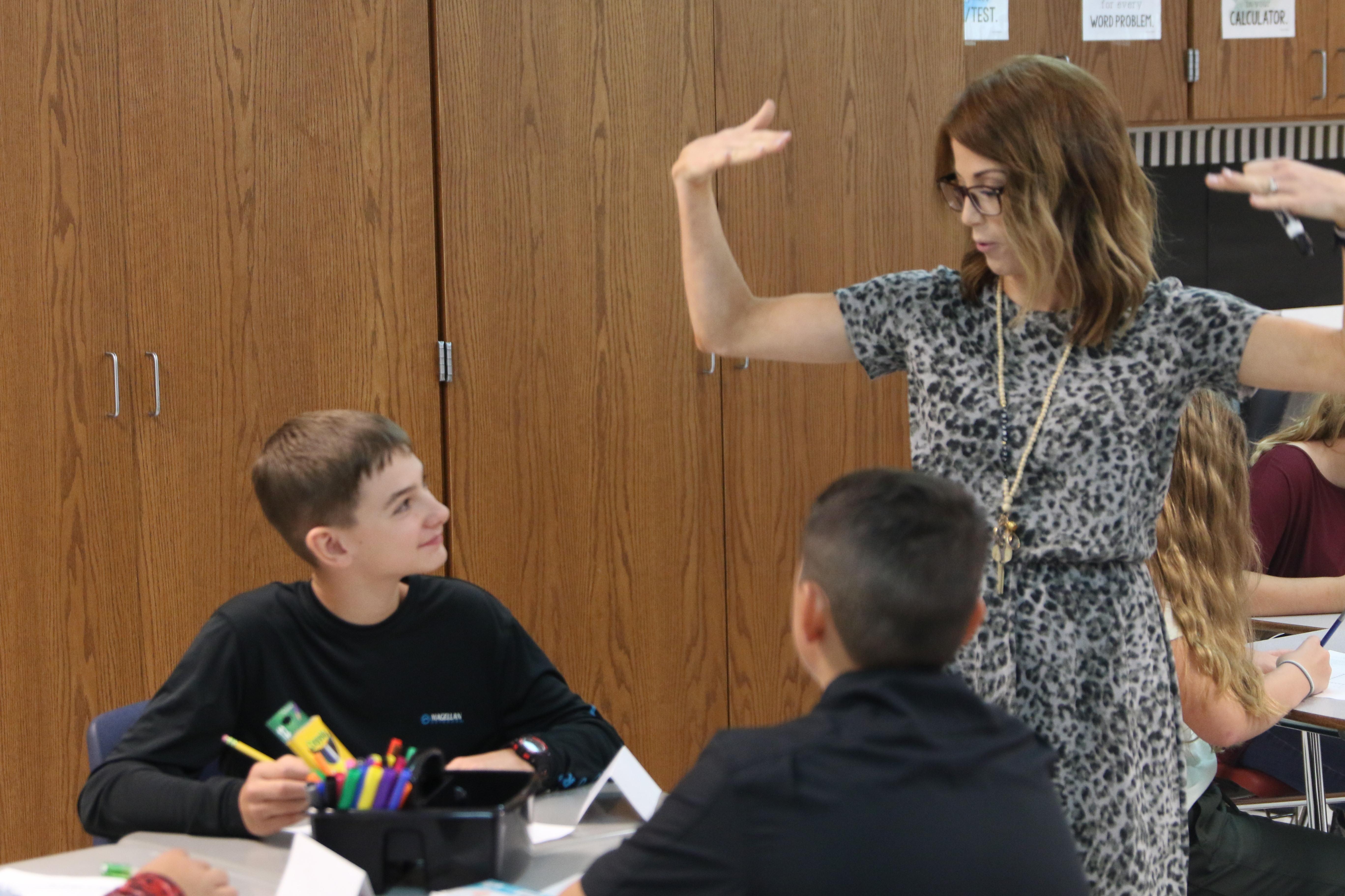 Teacher teaching boy