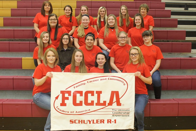 FCCLA students holding a banner