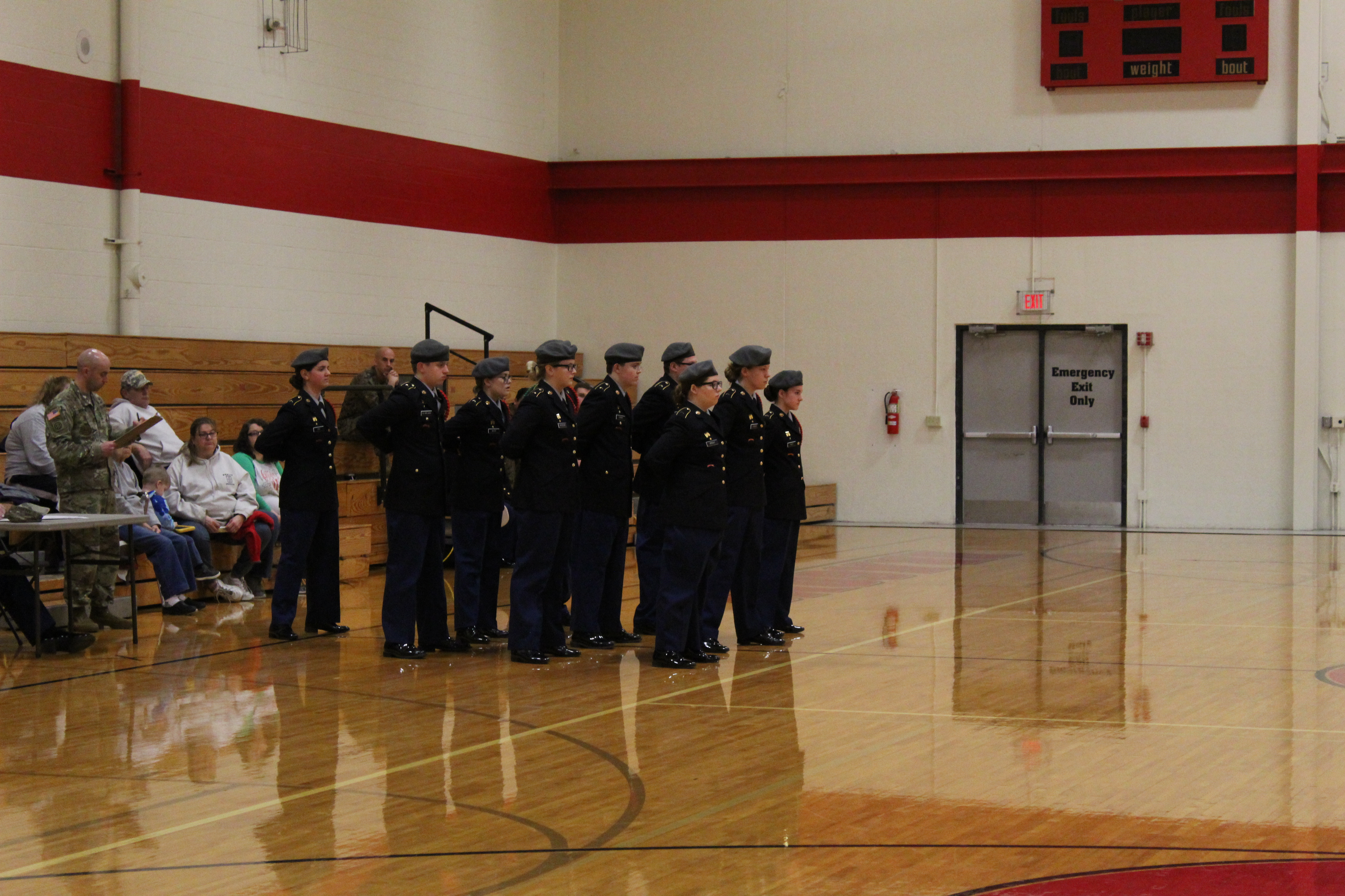 A photo of the drill team in the school gym