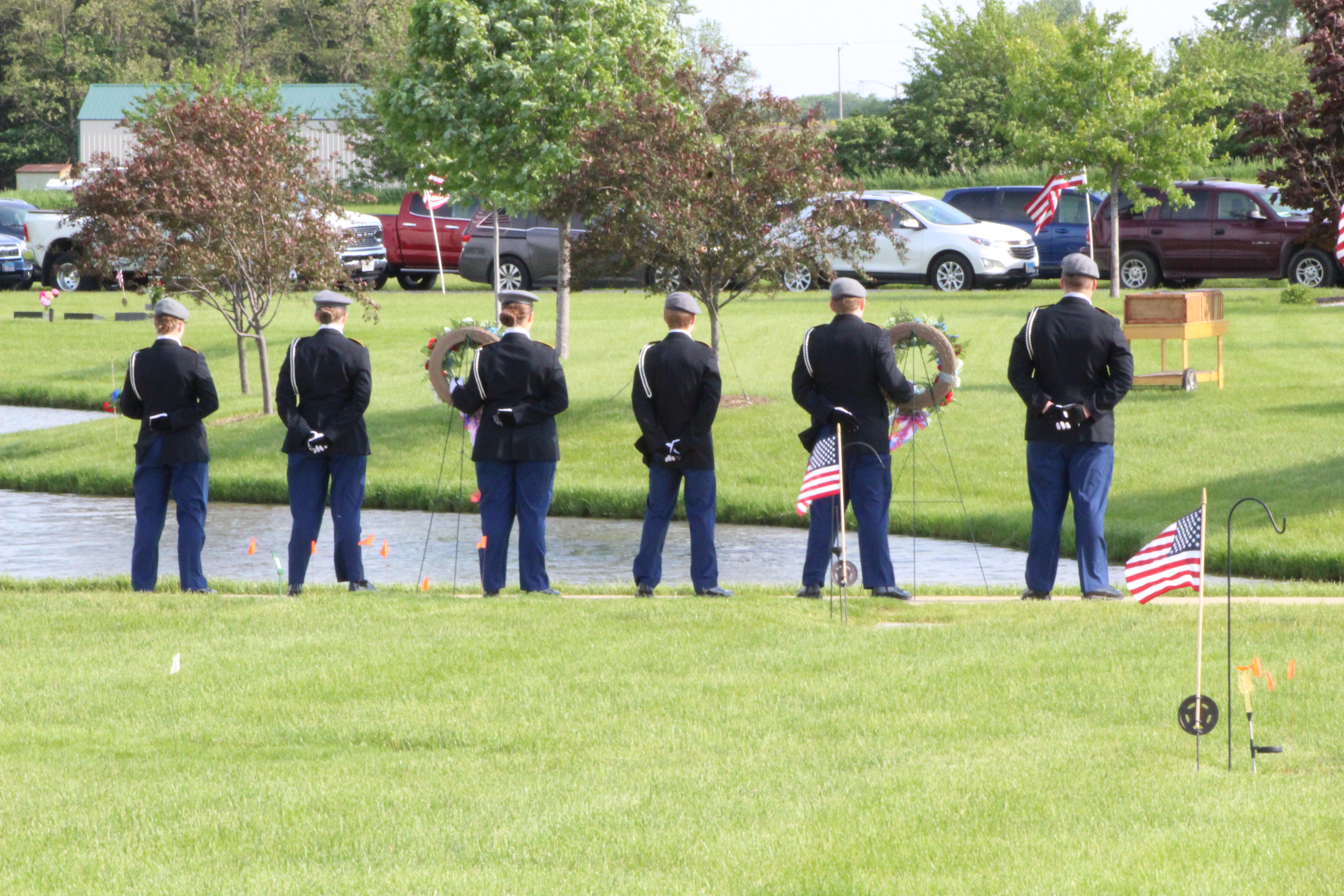 A photo of the honor guard at a ceremony outside